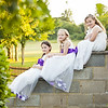 Young bridesmaids sitting on a wall for a portrait