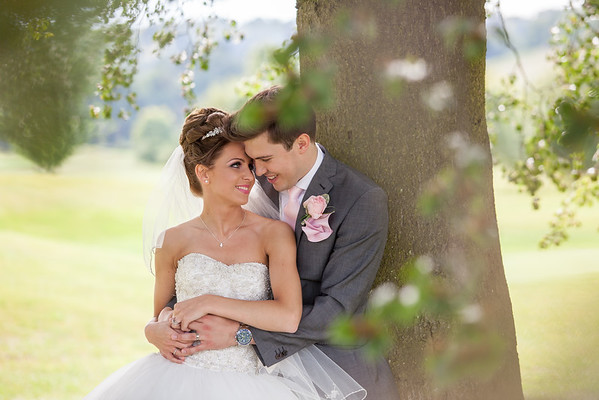 Bride and groom cuddling up at Woldingham Golf Club