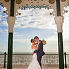 Formal portrait of a bride and groom at Brighton Bandstand, West Sussex