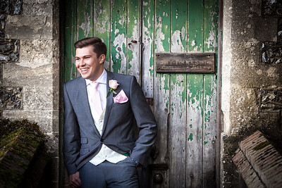 Groom portrait taken against a grunge styled door