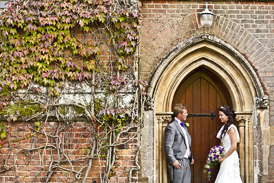 Bride and groom standing in the doorway at Royal Garrison Church Of All Saints