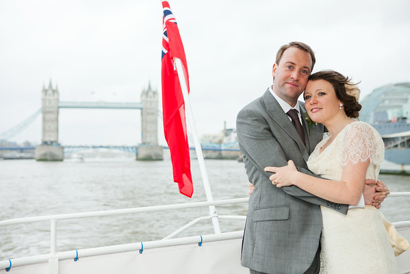 Bride and groom on a riverboat on the River Thames in London