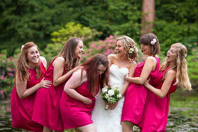 Bride and bridesmaids enjoying a joke at Coverwood Lakes