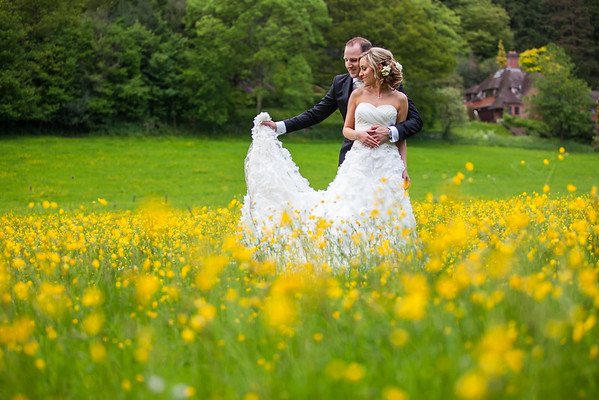 Bride and groom portrait taken in a sea of yellow flowers