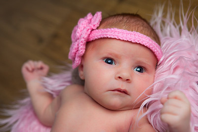 Newborn baby girl wearing a pink headband