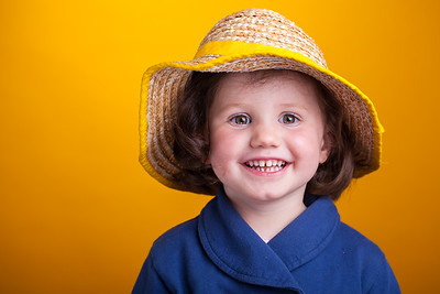 Vibrant portrait of a young girl wearing a bonnet hat