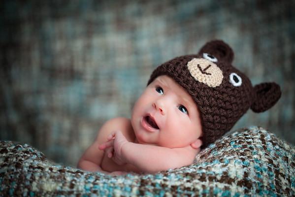 Newborn baby girl wearing a bear hat