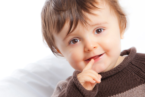 Portrait of a little boy with his finger in his mouth