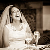 Bride finds her father's speech hilarious during the wedding breakfast at the Burford Bridge