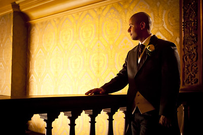 Groom causally posing for a portrait at Addington Palace in Croydon, Surrey
