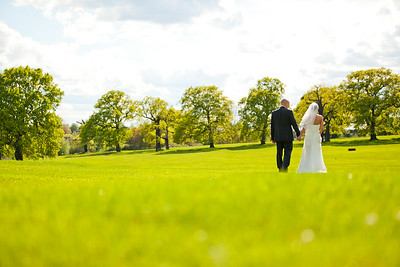 Bride and groom going for a stroll in Morden Park after their registry office wedding