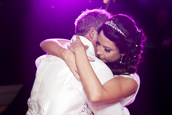 Atmospheric first dance embrace at Foxhills, Ottershaw