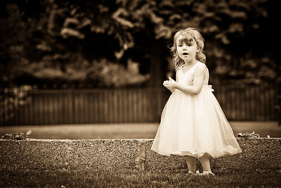 Young bridesmaid playing by herself