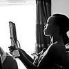 Bride holding a mirror and assessing her makeup preparing for her big day