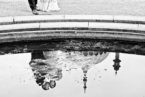 Reflection of bride and groom in the pond at the Royal Pavilion at Brighton