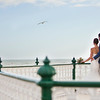 Bride and groom overlooking the seafront at Brighton Band Stand, West Sussex