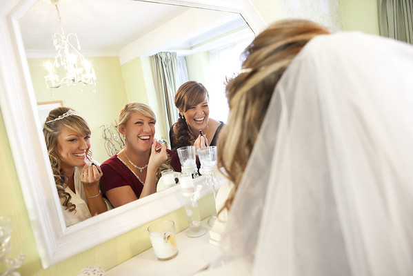 Bride and her bridesmaids getting ready at home