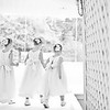 Three young bridesmaids going for a walk