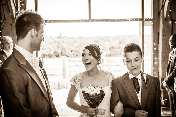 Bride's reaction to seeing her groom at the aisle