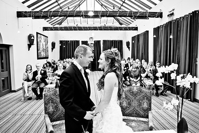 Bride and groom face each other whilst declaring their vowels at Lythe Hill Hotel & Spa