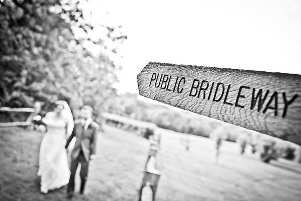 Bride and groom walking along a public bridlepath at the Surrey National Gold club