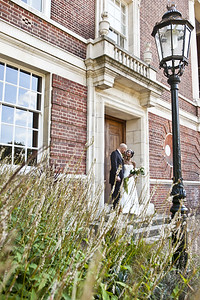 Bride and groom pose for a portrait outside Davenport House in London