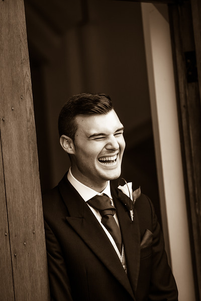 Natural laughter from a groom just before his wedding ceremony