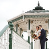 A bride and groom have a portrait at the band stand in Brighton