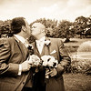 A groom and father-in-law mock a kiss at Gatton Manor Golf Club