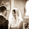 Bride beaming from ear to ear at her groom standing at the altar