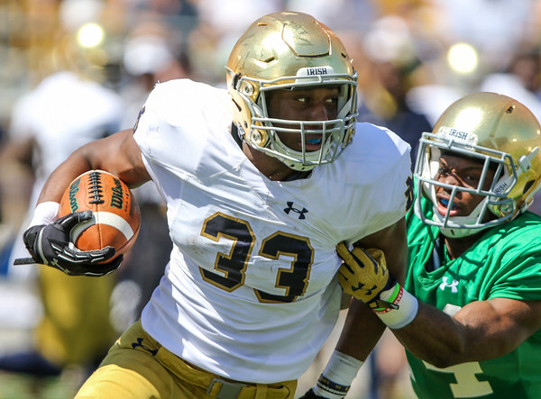 CHAD WEAVER   THE GOSHEN NEWS<br /> Notre Dame running back Josh Adams tries to escape cornerback Shaun Crawford during the second quarter of Saturday's Blue-Gold Game at Notre Dame Stadium.
