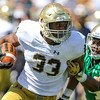 CHAD WEAVER | THE GOSHEN NEWS<br /> Notre Dame running back Josh Adams tries to escape cornerback Shaun Crawford during the second quarter of Saturday's Blue-Gold Game at Notre Dame Stadium.