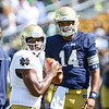 CHAD WEAVER | THE GOSHEN NEWS<br /> DeShone Kizer looks on as fellow quarterback Malik Zaire winds up a pass during warmups prior to the start of Saturday's Blue-Gold Game at Notre Dame Stadium.