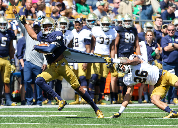 CHAD WEAVER   THE GOSHEN NEWS<br /> Notre Dame wide receiver Kevin Stepherson tries to escape from cornerback Ashton White during the second quarter of Saturday's Blue-Gold Game at Notre Dame Stadium.