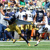 CHAD WEAVER | THE GOSHEN NEWS<br /> Notre Dame wide receiver Kevin Stepherson tries to escape from cornerback Ashton White during the second quarter of Saturday's Blue-Gold Game at Notre Dame Stadium.