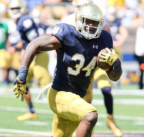 CHAD WEAVER | THE GOSHEN NEWS<br /> Notre Dame running back Dexter Williams runs the ball during the second quarter of Saturday's Blue-Gold Game at Notre Dame Stadium.