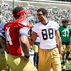 CHAD WEAVER | THE GOSHEN NEWS<br /> Injured Notre Dame wide receiver Corey Robinson talks with quarterback DeShone Kizer following Saturday's Blue-Gold Game at Notre Dame Stadium.