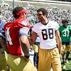 CHAD WEAVER | THE GOSHEN NEWS<br /> Injured Notre Dame wide receiver Corey Robinson talks with quarterback DeShone Kizer following Saturday's Blue-Gold Game at Notre Dame Stadium.