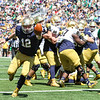 CHAD WEAVER | THE GOSHEN NEWS<br /> Notre Dame quarterback Montgomery VanGorder rushes for a touchdown late in the second half of Saturday's Blue-Gold Game at Notre Dame Stadium.