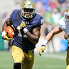 CHAD WEAVER | THE GOSHEN NEWS<br /> Notre Dame running back Justin Brent carries the ball during the second half of Saturday's Blue-Gold Game at Notre Dame Stadium.