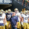 CHAD WEAVER | THE GOSHEN NEWS<br /> Head coach Brian Kelly lines up with the team as the exit the tunnel prior to the start of Saturday's Blue-Gold Game at Notre Dame Stadium.