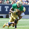 CHAD WEAVER | THE GOSHEN NEWS<br /> Notre Dame running back Tarean Folston is tackled by linebacker James Onwualu during the first quarter of Saturday's Blue-Gold Game at Notre Dame Stadium.