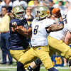CHAD WEAVER | THE GOSHEN NEWS<br /> Notre Dame defensive lineman Isaac Rochelle closes in on Quarterback Malik Zaire during the first quarter of Saturday's Blue-Gold Game at Notre Dame Stadium.