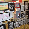 Kathryn Uebinger looks at art work on the opposite side of this display in the Effingham Public Library during the 20th annual Children's Art Show, sponsored by the Effingham Art Guild. Dawn Schabbing photo