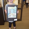 "Mia Totten, 7 of Altamont, stands holding her crayon art work titled, ""Elf Shoes,"" at the Children's Art Show, 2019. Dawn Schabbing photo"