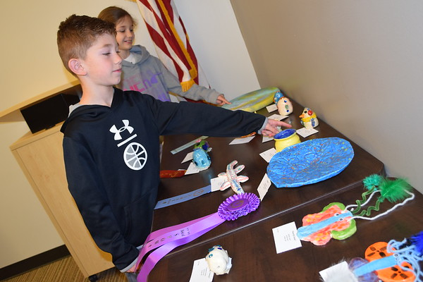 Kathryn and James Uebinger found their art show entries in their grade level group at the Effingham Public Library display. Dawn Schabbing photo