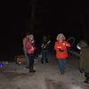 Volunteers handed out glow necklaces and glow sticks to attendees Saturday night.