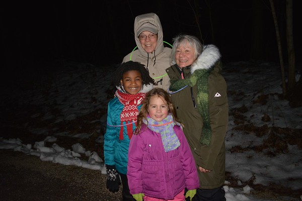 Despite the bitter cold, Gunner and Shirley Taylor, both of Arcola, were glad to bring their granddaughters Christina and Feifer Smith, both of Bloomington, to the 9th Annual Candlelight Walk Saturday night.