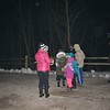 Volunteers gave glow necklaces and glow sticks to attendees Saturday night at the General Dacey Trail.