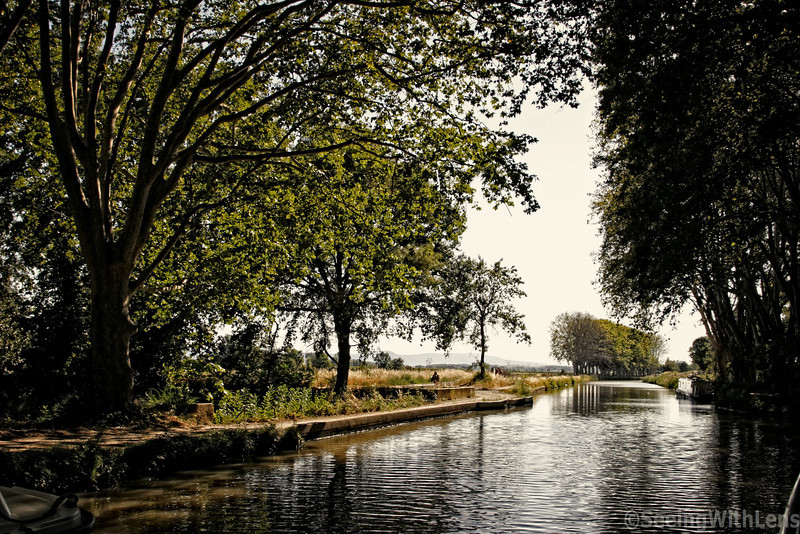 A flatboat cruise along the Canal du Midi. The Canal du Midi is a 241 km long canal in Southern France. It was originally named the Canal royal en Languedoc but the French revolutionaries renamed it to Canal du Midi in 1789